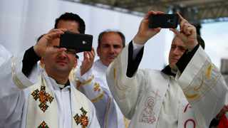 """The Catholic Church in Germany hopes to turn 50 new priests into social media influencers by offering a two-day """"smart camp"""". File Picture: Yara Nardi/Reuters"""