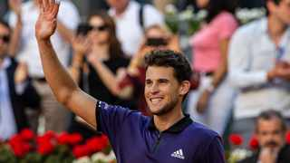 Dominic Thiem celebrates after beating Roger Federer at the Madrid Open on Friday. Photo: Bernat Armangue/AP