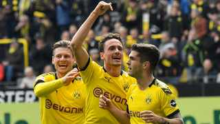 Dortmund's Christian Pulisic celebrates his opening goal with Thomas Delaney and Lukasz Piszczek, from right, during the German Bundesliga soccer match against Fortuna Duesseldorf in Dortmund on Saturday. Photo: Martin Meissner/AP