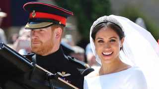 Britain's Prince Harry and his wife Meghan Markle leave after their wedding ceremony, at St. George's Chapel in Windsor Castle in Windsor. Picture: AP