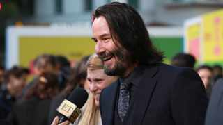 """Keanu Reeves speaks with journalists as he arrives at the premiere of """"Always Be My Maybe"""" on Wednesday, May 22, 2019, at the Regency Village Theatre in Los Angeles. (Photo by Mark Von Holden/Invision/AP)"""
