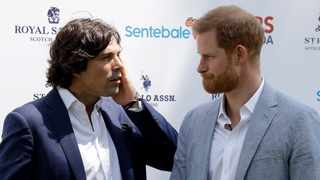 Britain's Prince Harry, Duke of Sussex, shares a word with Argentine Polo player Nacho Figueras, left, before taking part in the Sentebale ISPS Handa Polo Cup charity match at the Roma Polo Club, in Rome, Friday, May 24, 2019. (AP Photo/Andrew Medichini)