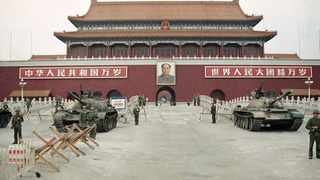 People's Liberation Army (PLA) troops stand guard with tanks in front of Tiananmen Square after crushing the students' pro-democracy demonstrations in Beijing on June 10, 1989. File picture: Sadayuki Mikami/AP