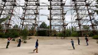 "Visitors inspect constructions of a former Soviet Union over-the-horizon (OTH) radar system ""Duga"" near the Chernobyl Nuclear Power Plant, near Chernobyl. Picture: Reuters"