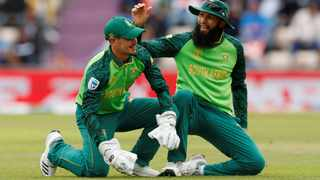 Quinton de Kock is all smiles alongside Hashim Amla after diving to his right to get rid of Indian captain Virat Kohli. Photo: Action Images via Reuters