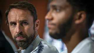 In this image made available by UEFA, England head coach Gareth Southgate, left, looks across at England defender Joe Gomez during a press conference prior the UEFA Nations League third-place playoff soccer match against Switzerland at Estadio D. Afonso Henriques in Guimaraes in Portugal. Photo: Octavio Passos/AP