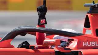 Ferrari driver Sebastian Vettel of Germany gestures after winning pole position during qualifying for the Formula One Canadian Grand Prix auto race in Montreal. Photo: Graham Hughes/AP