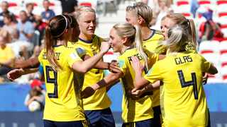 Sweden's Elin Rubensson celebrates scoring their fifth goal from the penalty spot with teammates. Photo: Eric Gaillard/Reuters