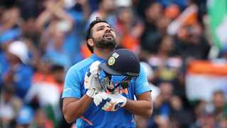 India's Rohit Sharma looks skywards to celebrate scoring a century during their Cricket World Cup match against Pakistan at Old Trafford in Manchester on Sunday. Photo: Aijaz Rahi/AP