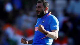 India's Mohammed Shami celebrates taking the wicket of Afghanistan's Mujeeb Ur Rahman to complete his hat-trick and win the match on Saturday. Photo: Paul Childs/Reuters