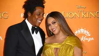 Singers Jay-Z, left, and Beyoncé pose for photographers upon arrival at the 'Lion King' European premiere in central London. Picture: AP