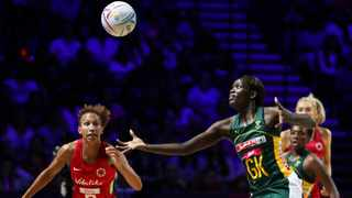 South Africa's Phumza Maweni and England captain Serena Guthrie, left, go for the ball during the Netball World Cup bronze medal match. Photo: Rui Vieira/AP