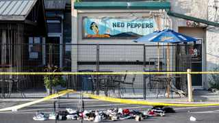 Shoes are piled outside the scene of a mass shooting including Ned Peppers bar on Sunday in Dayton, Ohio. Picture: John Minchillo/AP