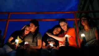From left, Melody Stout, Hannah Payan, Aaliyah Alba, Sherie Gramlich and Laura Barrios comfort each other during a vigil for victims of the shooting. Picture: John Locher/AP