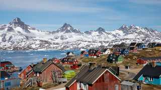 Snow-covered mountains rise above the harbour and town of Tasiilaq, Greenland. File picture: Lucas Jackson/Reuters