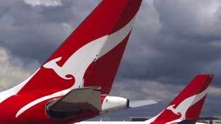 Two Qantas Airways Airbus A330 aircraft can be seen on the tarmac near the domestic terminal at Sydney Airport. Picture by David Gray for Reuters