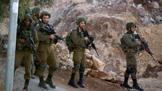 Israeli forces patrol near the area of an attack, west of the West Bank city of Ramallah. Picture: AP Photo/Majdi Mohammed