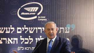 Israeli Prime Minister Benjamin Netanyahu speaks during a cornerstone ceremony for the Mobileye campus, in Jerusalem.   The new 135,000-square meter campus of offices and laboratories for Mobileye and Intel. (Abir Sultan/Pool Photo via AP)