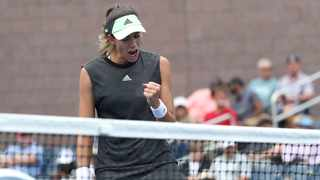 Garbine Muguruza won consecutive matches for the first time since last year's French Open when she beat American Shelby Rogers 6-1 7-6(2) to advance to the quarter-finals of the Shenzhen Open on Wednesday. Photo: Eduardo Munoz Alvarez/AP Photo