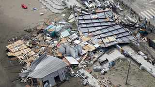 Beach houses are damaged as typhoon hits the beacfront area in Miura, south of Tokyo. Picture: Kyodo News via AP