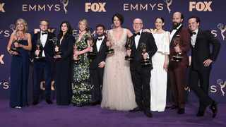 """Harry Bradbeer, fourth from right, winner of the award for outstanding directing for a comedy series, and the cast and crew of """"Fleabag,"""" winners of the award for outstanding comedy series, pose in the press room at the 71st Primetime Emmy Awards on Sunday, Sept. 22, 2019, at the Microsoft Theater in Los Angeles. Picture: Jordan Strauss/Invision/AP"""