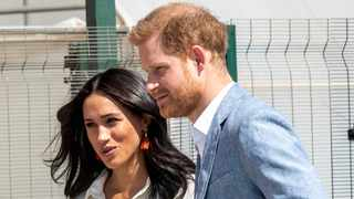 Britain's Prince Harry and Meghan, Duchess of Sussex, visit a Youth Employment Services Hub in Makhulong, Tembisa, a township near Johannesburg, on Wednesday. Picture: AP