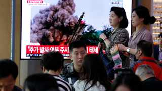 People watch a TV showing a file image of an unspecified North Korea's missile launch during a news program at the Seoul Railway Station in Seoul, South Korea, Wednesday, Oct. 2, 2019. North Korea on Wednesday fired projectiles toward its eastern sea, South Korea's military said. File photo: AP Photo/Ahn Young-joon.