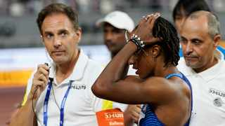 Brianna McNeal, of the United States, reacts after being disqualified for a false start in a women's 100 metre hurdles heat at the World Athletics Championships in Doha, Qatar, on Saturday. Photo: David J. Phillip/AP