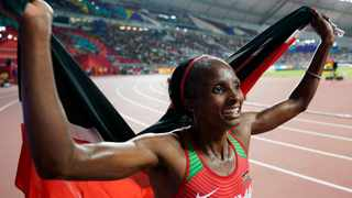Hellen Obiri of Kenya celebrates after winning the gold medal in the women's 5000-metre final at the World Athletics Championships in Doha on Saturday. Photo: David J. Phillip/AP