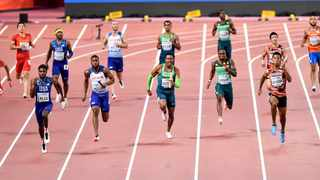 Noah Lyles of the United States, second from left, runs to win the men's 4x100 meter relay final ahead of silver medalist Nethaneel Mitchell-Blake of Great Britain & NI, 3rd row from left, and third placed Sani Brown of Japan. Photo: AP Photo/Martin Meissner