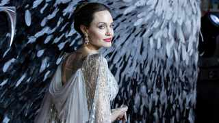 Actress Angelina Jolie poses for photographers on arrival at the European premiere of the film 'Maleficent Mistress of Evil' in central London on Wednesday, Oct. 9, 2019. Picture: Grant Pollard/Invision/AP