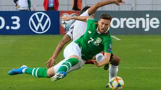 Ireland's Matt Doherty, front, fights for the ball with Georgia's Tornike Okriashvili during their Euro 2020 group D qualifying match at Boris Paichadze Erovnuli Stadium in Tbilisi on Saturday. Photo: Shakh Aivazov/AP