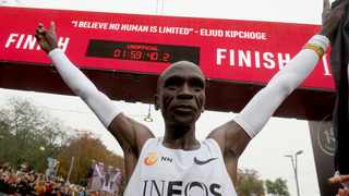 Marathon runner Eliud Kipchoge from Kenya celebrates under the clock after crossing the finish line of the INEOS 1:59 Challenge after 1:59:40 in Vienna, Austria, Saturday, Oct. 12, 2019. Photo: AP Photo/Ronald Zak
