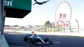 Mercedes driver Valtteri Bottas of Finland gets the checkered flag while crossing the finish line to win the Japanese Formula One Grand Prix at Suzuka Circuit in Suzuka, central Japan, Sunday, Oct. 13, 2019. (Kim Hong-Ji/Pool Photo via AP)