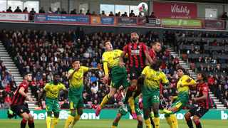 Norwich City's Kenny McLean, left, and Bournemouth's Callum Wilson battle for a header during their English Premier League match at the Vitality Stadium in Bournemouth on Saturday. Photo: Mark Kerton/AP