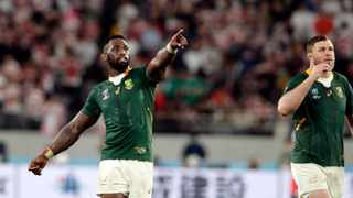 South Africa players celebrates after defeating Japan during the Rugby World Cup quarterfinal match at Tokyo Stadium between Japan and South Africa in Tokyo, Japan. AP Photo/Mark Baker