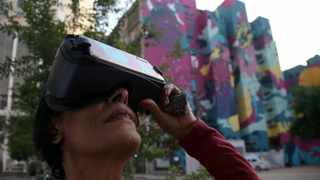 "A woman uses virtual reality (VR) glasses as part of  ""Aquario Urbano"" or ""Urban Aquarium"", a project that mixes 10.000 m2 of graffiti with VR experience, in Sao Paulo"