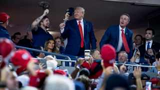 President Donald Trump stands as members of the military are recognised during Game 5 of a baseball World Series between the Houston Astros and the Washington Nationals at Nationals Park in Washington. Picture: Andrew Harnik/AP/African News Agency (ANA)