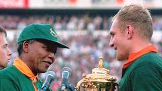 Francios Pienaar receives the Rugby World Cup from former president Nelson Mandela. Photo: Ross Setford/AP