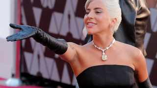 Lady Gaga was stopped by security after leaving the Oscars with her Tiffany necklace, the priceless 128-carat yellow diamond last worn by Audrey Hepburn in 1961. Picture: Reuters
