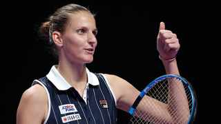 Karolina Pliskova of the Czech Republic gestures to her fans after defeating Simona Halep of Romania in the WTA Finals Tennis Tournament at the Shenzhen Bay Sports Center on Friday..  Photo: AP Photo/Andy Wong