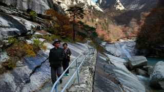 Local tourists walk on the trail at Mount Kumgang, known as Diamond Mountain. Picture: AP