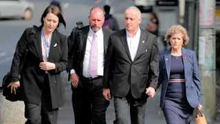 Parents of murdered British backpacker Grace Millane arrive at the Auckland High Court, in Auckland, New Zealand. Picture: Michael Craig/NZ Herald via AP