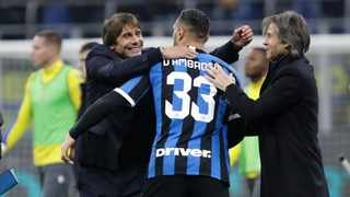 Inter Milan's head coach Antonio Conte, left, celebrates with Danilo D'Ambrosio, centre, and team manager Gabriele Oriali at the end of the Serie A match against Hellas Verona at the San Siro Stadium in Milan on Saturday. Photo: Luca Bruno/AP