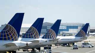 United Airlines commercial jets sit at a gate at Terminal C of Newark Liberty International Airport in Newark. Picture: AP