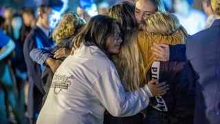 People hug each other during a vigil for the Saugus High School shooting victims at Central Park in Santa Clarita, California. Picture: Hans Gutknecht/The Orange County Register/SCNG via AP