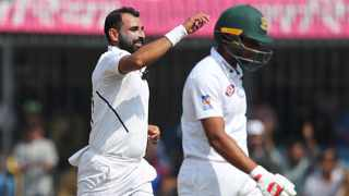 India's Mohammed Shami, left, celebrates the dismissal of Bangladesh's Mahmudullah, right, during the third day of the first cricket Test match between the two countries in Indore, India on Saturday. Photo: Aijaz Rahi/AP