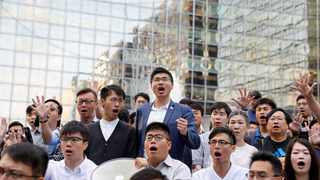 Pro-democratic winning candidates at district council local elections gather outside the campus of the Polytechnic University (PolyU) in Hong Kong. Picture: Adnan Abidi/Reuters