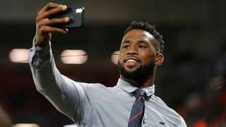 FILE - South African rugby international Siya Kolisi takes a selfie on the pitch before the Champions League match between Liverpool and Napoli at Anfield. Photo: Phil Noble/Reuters
