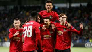 Manchester United's Jesse Lingard celebrates scoring their first goal against Astana with Mason Greenwood and other academy graduates. Photo: Valentyn Ogirenko/Reuters